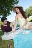 Portrait young couple during romantic picnic in countryside Royalty Free Stock Photos