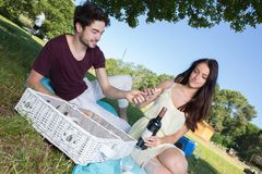 Portrait young couple during romantic picnic in countryside Stock Image