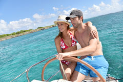 Portrait of young couple on the sailing boat navigating Stock Photos