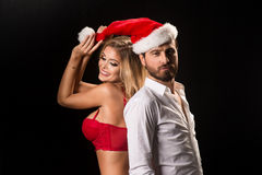 Portrait of a young couple with Santa hat Stock Images
