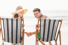 Portrait of young couple sitting on armchair Stock Image