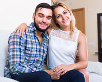 Portrait of young couple sitting on couch Royalty Free Stock Photo