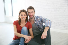 Portrait of a young couple sitting on the floor Royalty Free Stock Image