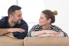 Portrait of young couple sitting on sofa royalty free stock photo