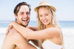 Portrait of young couple sitting together on the beach Stock Image