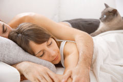 Portrait of a young couple sleeping on bed Royalty Free Stock Photo