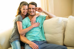 Portrait of young couple smiling and embracing Stock Images