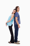 Portrait of a young couple standing back to back Stock Photo