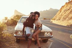 Portrait Of Young Couple Standing Next To Classic Car Royalty Free Stock Photography