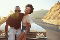 Portrait Of Young Couple Standing Next To Classic Car Stock Images
