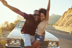 Portrait Of Young Couple Standing Next To Classic Car Royalty Free Stock Photo