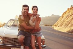 Portrait Of Young Couple Standing Next To Classic Car Stock Photography