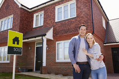 Portrait Of Young Couple Standing Outside New Home Royalty Free Stock Photography
