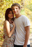 Portrait of young couple on stroll. Royalty Free Stock Images