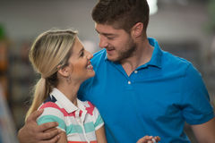 Portrait Of A Young Couple In Supermarket Stock Photography