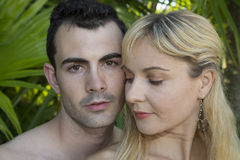 Portrait of a young couple with their heads close together Stock Photo
