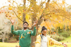 Portrait of a young couple throwing leaves around Royalty Free Stock Photos