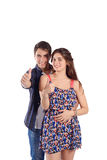 Portrait of a young couple with thumbs up. Royalty Free Stock Photo