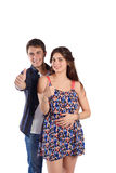 Portrait of a young couple with thumbs up. Royalty Free Stock Image
