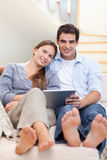 Portrait of a young couple using a tablet computer Royalty Free Stock Image