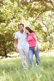 Portrait Of Young Couple Walking In Park. Smiling Royalty Free Stock Photos