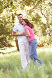 Portrait Of Young Couple Walking In Park Royalty Free Stock Images