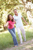 Portrait Of Young Couple Walking In Park. Having Fun Royalty Free Stock Photos