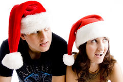 Portrait of young couple wearing christmas hat royalty free stock photography