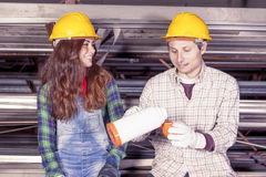 Portrait of young couple of workers Stock Photo