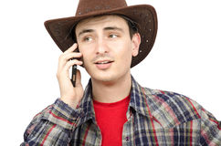 Portrait of young cowboy with ironic smile Royalty Free Stock Images