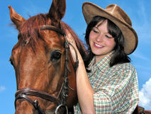 Portrait of young cowgirl and horse Royalty Free Stock Photo