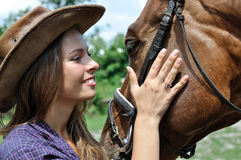 Portrait of young cowgirl and horse Royalty Free Stock Images