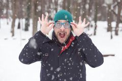 Portrait of young crazy man on snow day. Cheerful, funny, comic stock photos