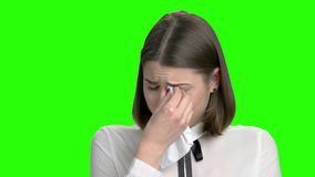 Portrait of young crying girl. Sad woman weeping with handkerchief. Green screen hromakey background for keying stock video