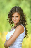 Portrait young curly hair woman arms crossed smiling Royalty Free Stock Photography