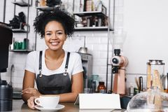 Portrait of a young curly waitress stock photos