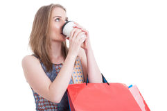 Portrait of young customer female drinking coffee while doing sh Stock Images
