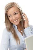 Portrait of young customer service representative. Portrait of happy young customer service representative, using headphones Stock Photo