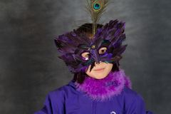 Portrait of a young cute girl with a mask looking at the camera royalty free stock photos