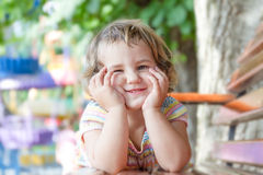 Portrait of young cute child girl on natural background Stock Photos