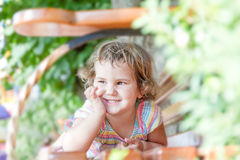 Portrait of young cute child girl on natural background Royalty Free Stock Photo