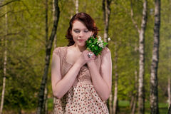 Portrait of young cute female with snowdrops Royalty Free Stock Photos