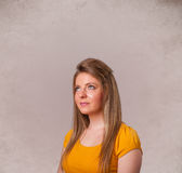 Portrait of a young cute girl with empty copy space. On grungy background Royalty Free Stock Photo