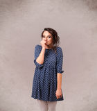 Portrait of a young cute girl with empty copy space. On grungy background Stock Photo