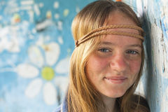 Portrait of young cute girl hippie, old dirty wall Royalty Free Stock Photography