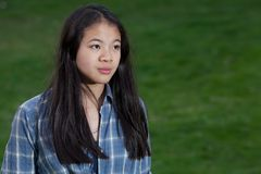 Portrait of a young cute girl looking at the camera stock photography