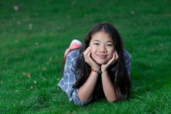 Portrait of a young cute girl looking at the camera stock images