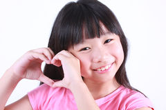 Portrait of young cute girl with red heart Stock Photo