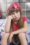 Portrait young cute girl of seven with bad makeup Royalty Free Stock Photos