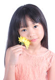 Portrait of young cute girl with yellow flower Stock Photo